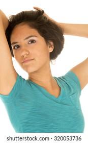 Beautiful Latino teenage girl pulling hair up