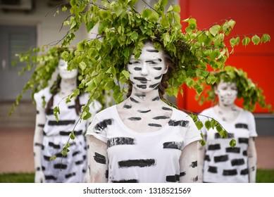 Beautiful Latvian girls in birch costume. Fashion performer style. Costumes imitation of birch grove. Rezekne, Latvia, May 27, 2017