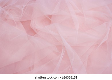 Beautiful layers of delicate pink fabric background.