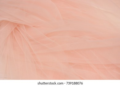 Beautiful layers of gentle pink background with tulle fabric clothes