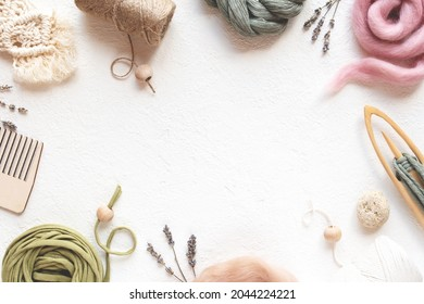 Beautiful layout of materials for macrame, weaving: cotton cords, jute twine, wooden beads. Flat lay. Hobby concept, copy space.