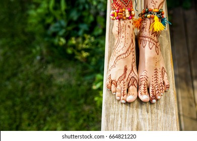 Beautiful legs with accessories and mehendi painting outdoors