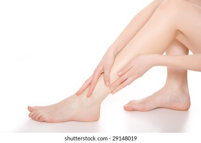 Beautiful legs and arm isolated on a white background