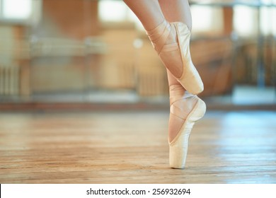 beautiful legs of a dancer in pointe