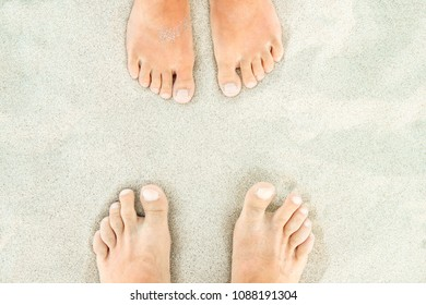 beautiful legs on sand near the sea shore on nature background
