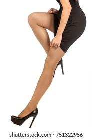 Beautiful legs in pantyhose.. Feet girl photographed in the studio.