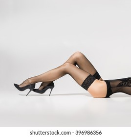 Beautiful legs in stockings over white background