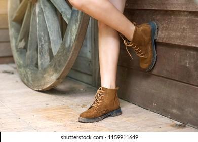 Beautiful legs wearing brown leather shoes. - Shutterstock ID 1159911649