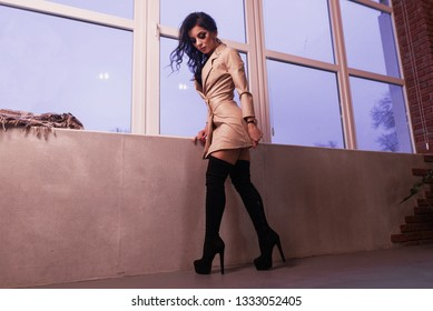 Beautiful legs woman with black knee high boots