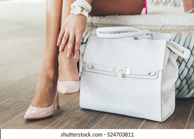 Beautiful legs woman with  hand bag