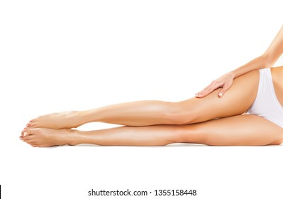 Beautiful legs of a young woman isolated on white background