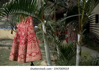 beautiful lehenga - bride's weddingdress hanging on a tree