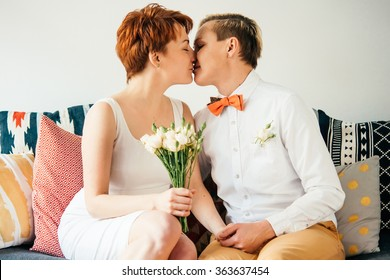 Beautiful lesbian couple kissing while celebrate their wedding. Gay marriage concept.