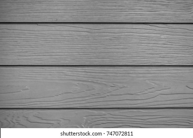 Beautiful light black color wooden plank patterns from cement striped wood wall, Close up wood substitute board and high quality of fiber board  texture and background for design and architect