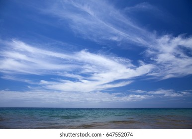 beautiful light cirrus clouds over ocean, natural background of predominantly sky