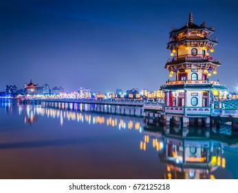 Beautiful light decorative pagoda at lotus pond in Kaohsiung city of Taiwan on important festival day at night blue twilight time, selective focus