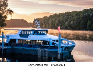 Beautiful Light, fog and reflections early in the morning at Waiau River Bay, the starting point of the cruises for Doubtful Sound on the side of lake Manapouri in Fiordland National Park, New Zealand