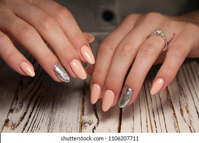 beautiful light manicure on a textured trendy background