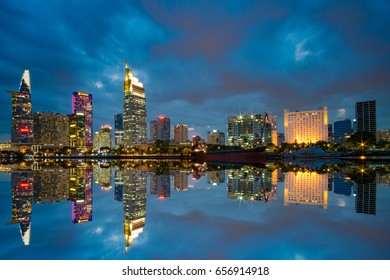 Beautiful light at night reflection in the riverside of Ho Chi Minh City - The biggest city in Vietnam
