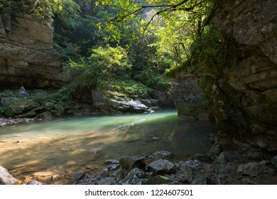Beautiful light of the sun on the water, river and rocks with trees in the Guam ravine