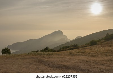 Beautiful light at sunset on the mountains and cliffs at the Mediterranean coast.