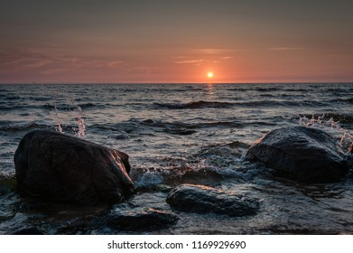 Beautiful light sunset over Baltic sea. The shore of Baltic beach in Kurmrags, Latvia.