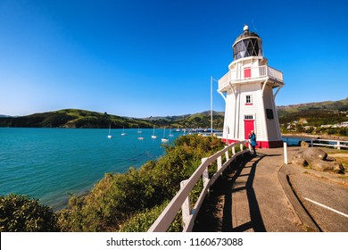 A beautiful lighthouse locate in Akaroa, New Zealand. This is a perfect holiday destination. It is popular among tourists, backpackers, and locals. One can enjoy clear blue sky, ocean, and shops.