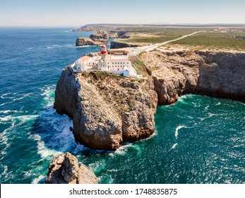 Beautiful lighthouse located on high cliffs of Saint Vincent cape  in Sagres, Algarve, Portugal