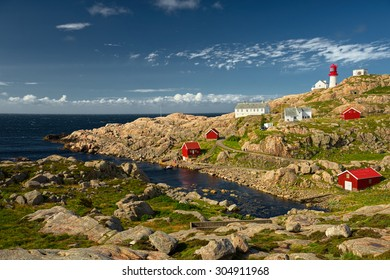 beautiful lighthouse on the edge of rocky sea coast, South Norway, Lindesnes Fyr beacon