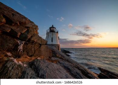 Beautiful lighthouse overlooking the ocean at sunset, near Newport Rhode Island