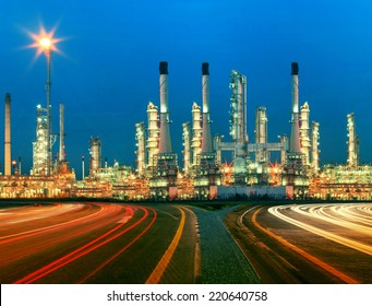 beautiful lighting of oil refinery plant in  heavy petrochemical industry estate use for power ,energy and petroleum industrial topic