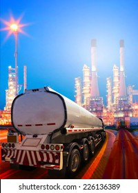 beautiful lighting of oil refinery plant in heavy petrochemical industry and container truck transportation of petroleum