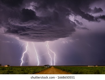 Beautiful lightning display with a moonlit foreground in Aguila, Arizona.
