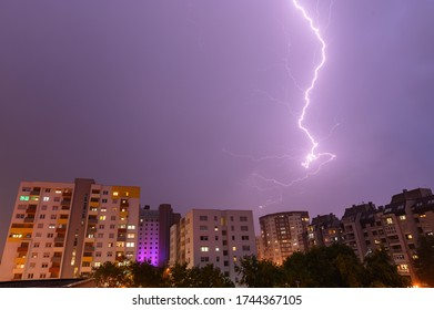 beautiful lightning over the city. The storm and thunder above the buildings and nature are fantastic.