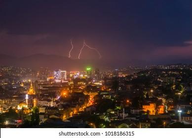 Beautiful lightning over the skyline of modern city at night