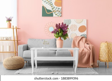 Beautiful lilac flowers on table in living room