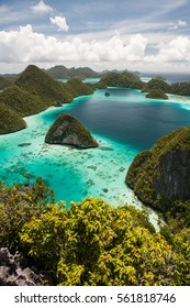 Beautiful limestone islands lie scattered within a remote lagoon in Wayag, Raja Ampat, Indonesia. This region is known for its incredible marine biodiversity and excellent diving and snorkeling.
