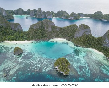 Beautiful limestone islands surround a tropical lagoon in Wayag, Raja Ampat, Indonesia. This stunning area is home to an extraordinary amount of tropical marine life.