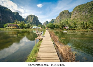 Beautiful limestones and water reflections in Rammang Rammang park near Makassar, South Sulawesi, Indonesia