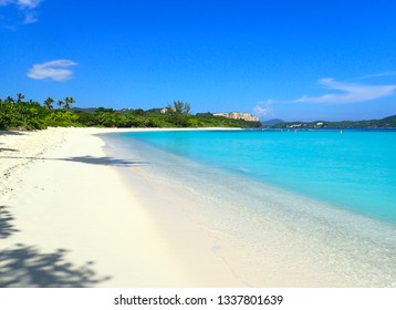 Beautiful Lindquist beach day on St. Thomas US Virgin Islands with clear blue skies, palm trees and turquoise water.