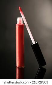 Beautiful lip glosses on dark background