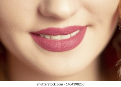 beautiful lips with matte lipstick,parts of the body, cosmetics and beauty concept