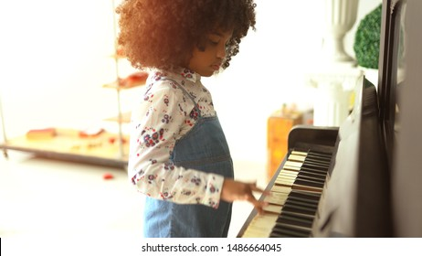 beautiful little african kids are playing on piano music