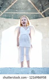 Beautiful little angel girl is singing