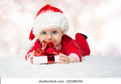 f28f0c4e69d4e Beautiful little baby celebrates Christmas. New Year's holidays. Baby in a Christmas  costume with