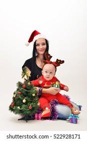 Beautiful little baby celebrates Christmas.