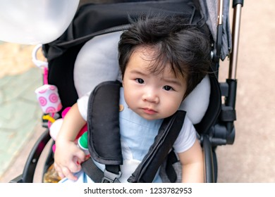 Beautiful little baby in stroller/  on carriage.