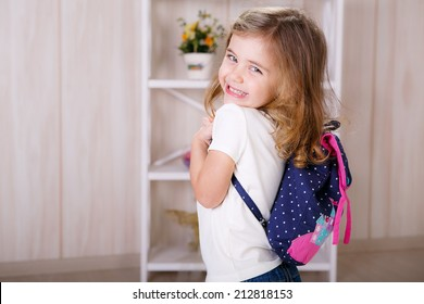 Beautiful little with a backpack