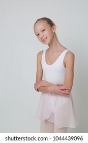 Beautiful little ballerina in studio