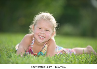 Beautiful little blond girl enjoying a day at the park